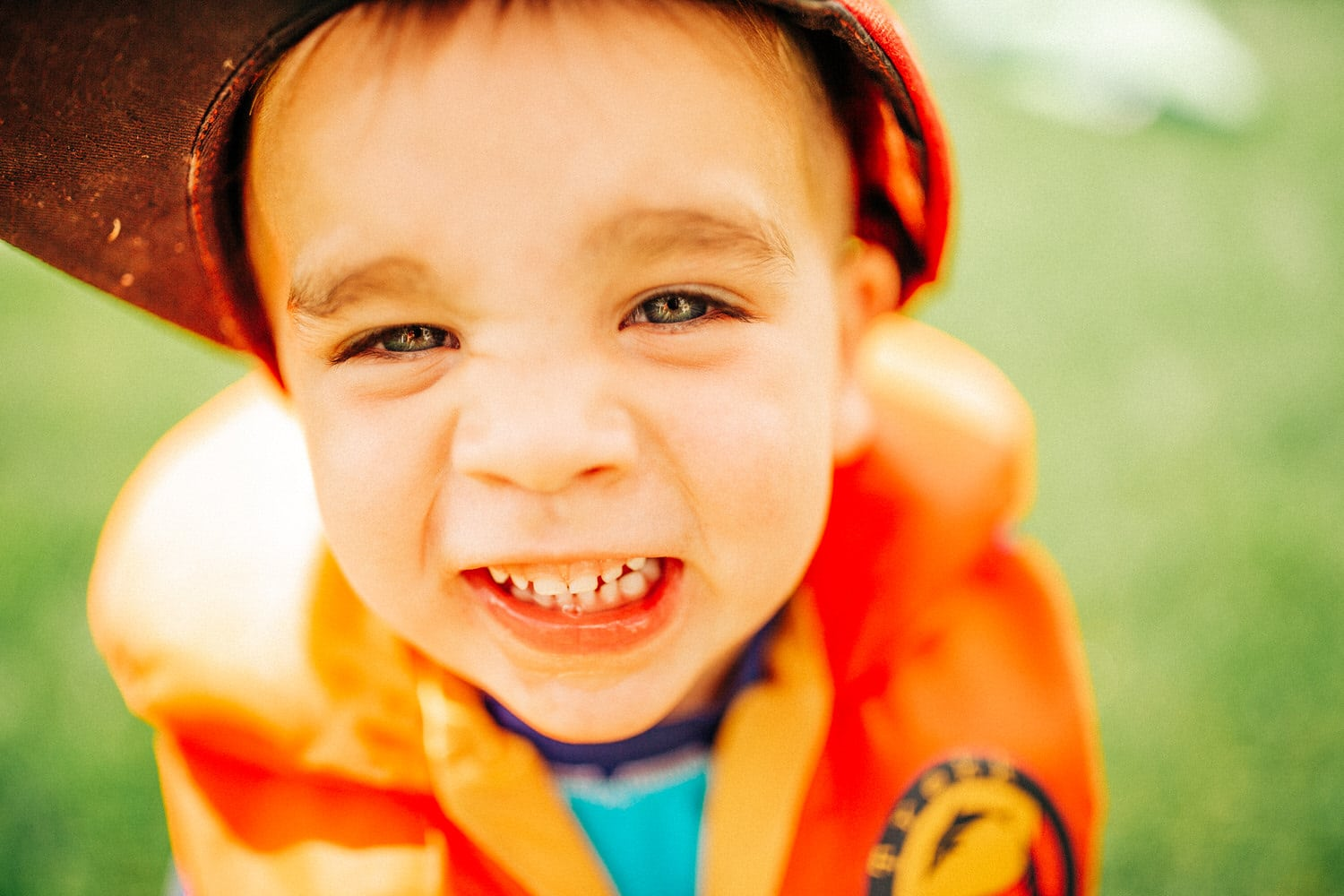 a toddler laughing and playing during a photography shoot in Calgary