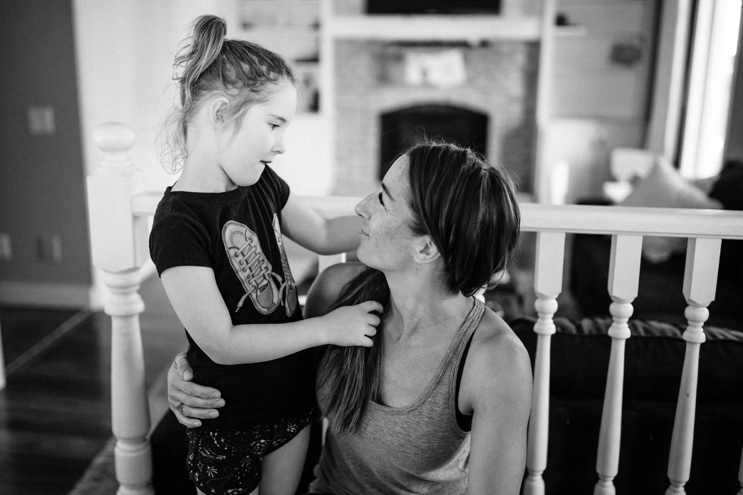Mom and young daughter photographed together during a Calgary photography shoot at the clients home