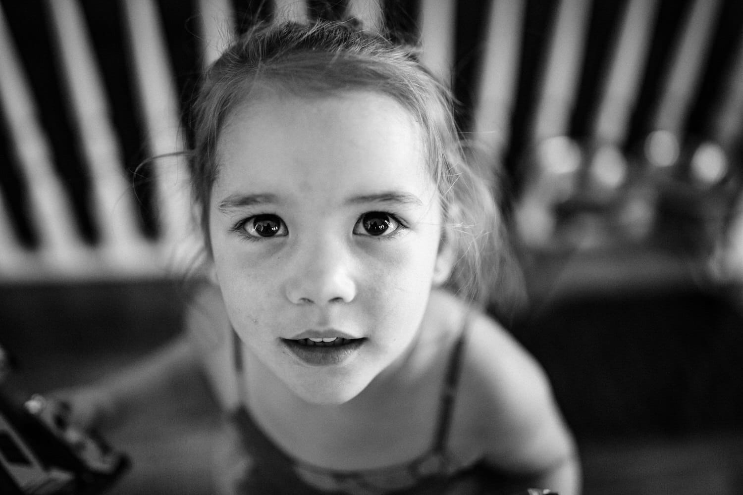 A toddler in her home playing during a Calgary photography shoot