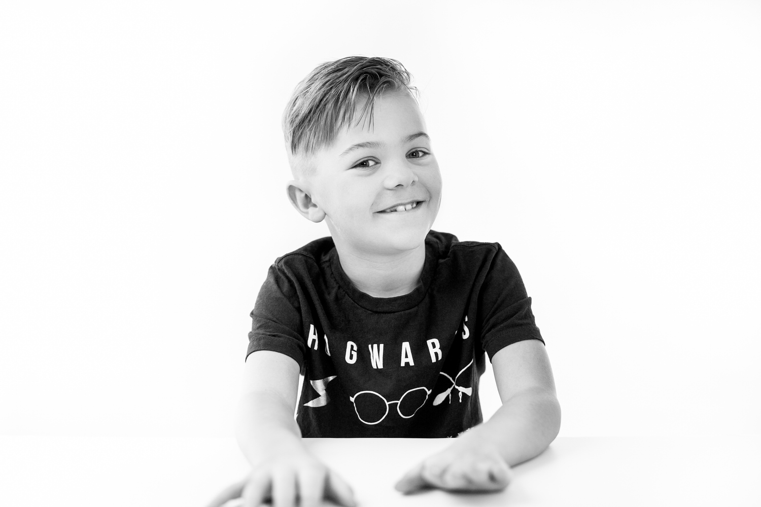 A boy laughing during a studio photography shoot in Calgary