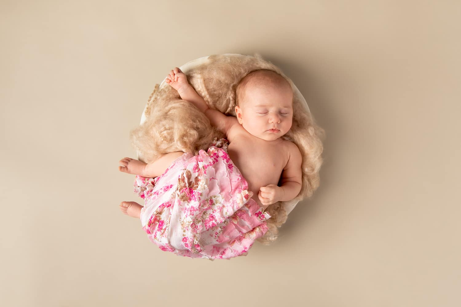 a professional baby photography shoot in Calgary located inside a studio