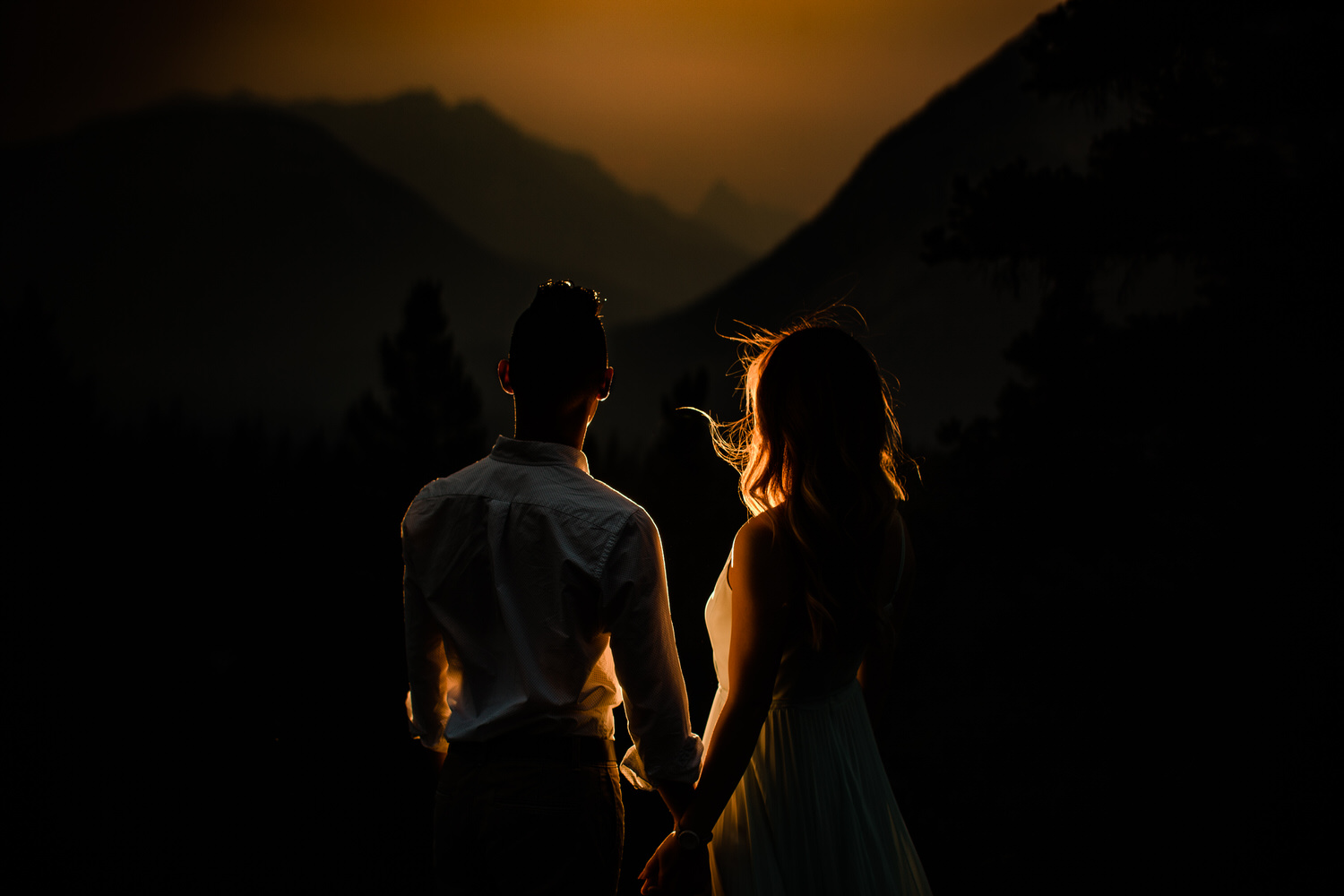 Engagement couple holding hands photo during the Banff National Park forest fire