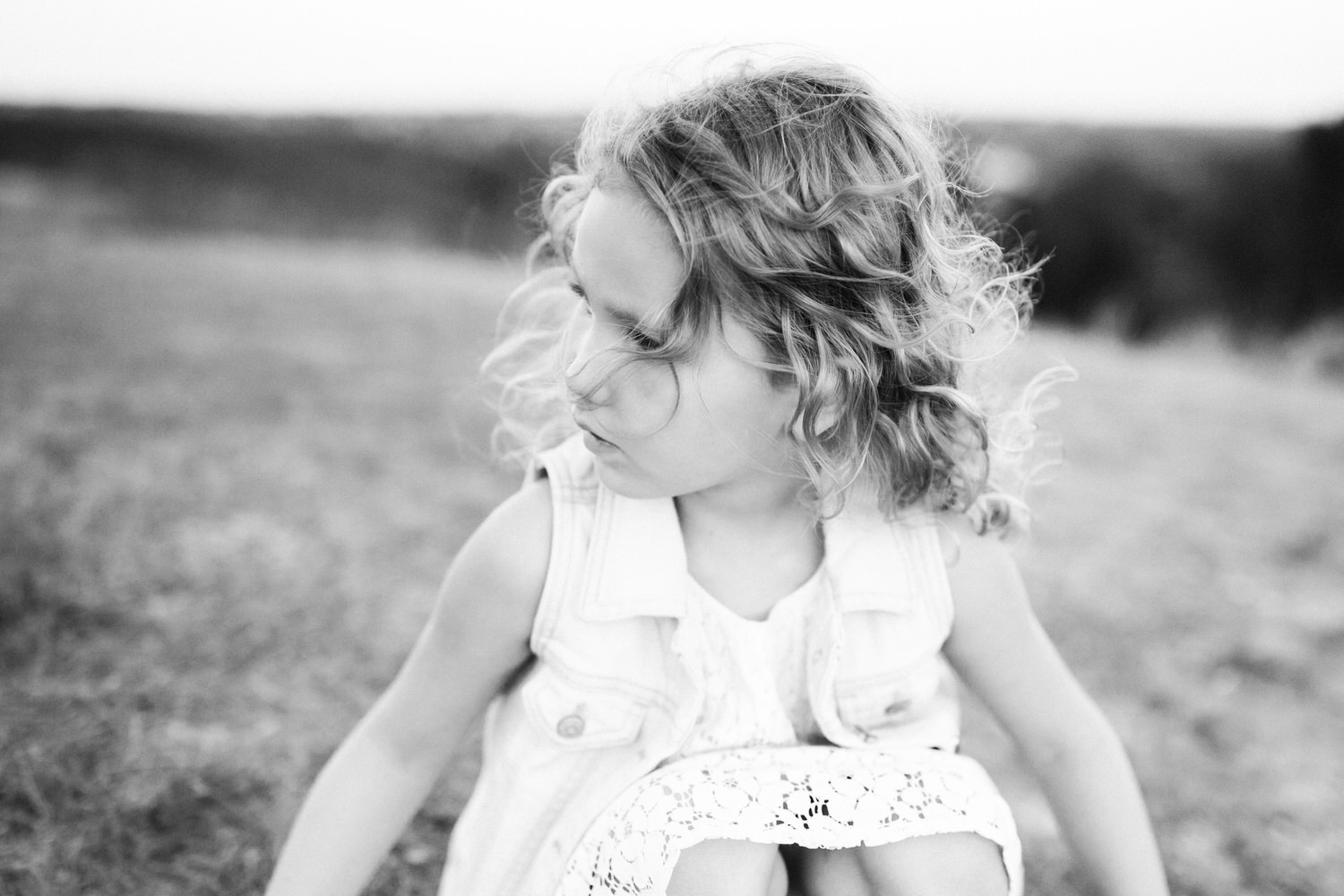 a toddler in fish creek during a family photography shoot