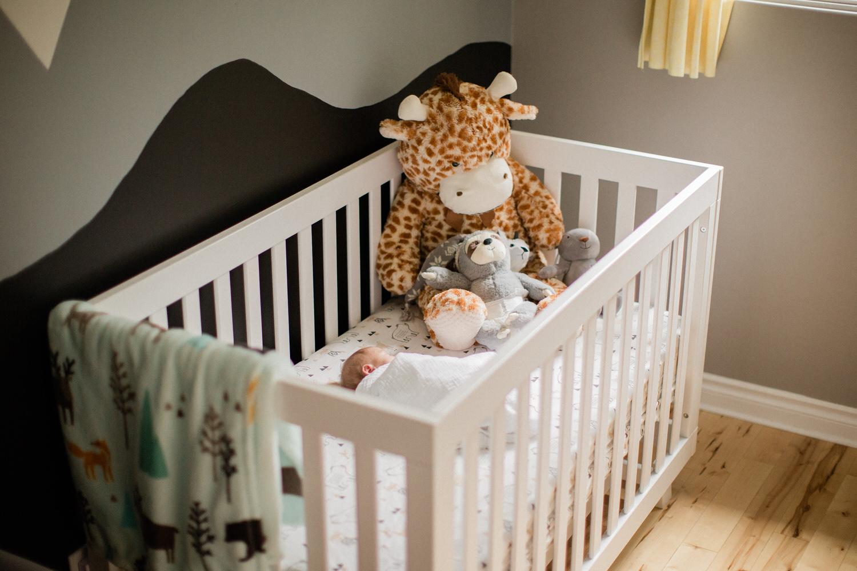 A newborn baby is sleeping in her crib