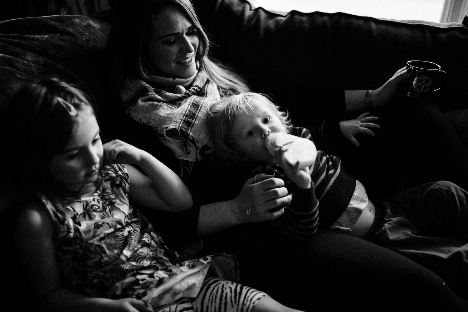 family fun photography shoot in black and white in Calgary at the clients home