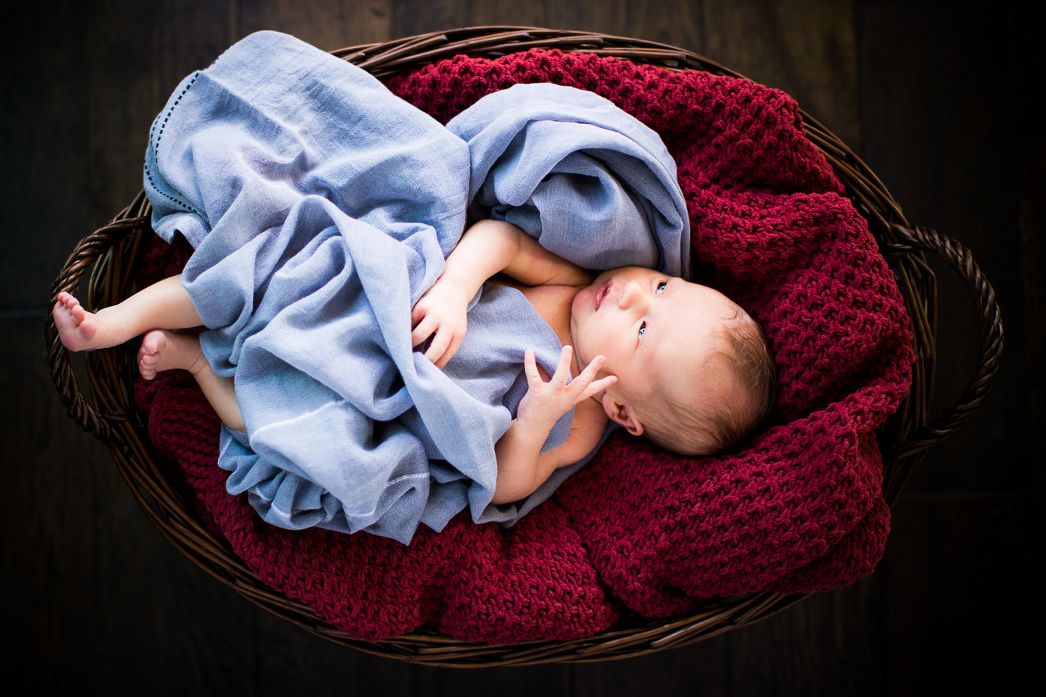 A newborn baby laying down during a photo shoot at the clients home in Calgary